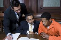 Criminal with two lawyers in court